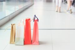 Colored paper packages on the floor in the mall, shopping concept. Soft focus background Royalty Free Stock Photo
