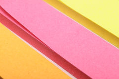 Colored paper pieces Royalty Free Stock Photos
