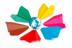 Colored paper planes and paper globe Stock Photos