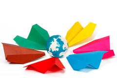 Colored paper planes and paper globe Stock Image