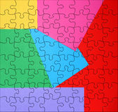 Colored paper puzzle royalty free stock images