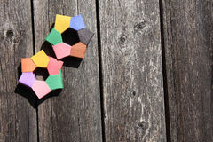 Colored paper rings. It is colored paper rings , wood for background Royalty Free Stock Image