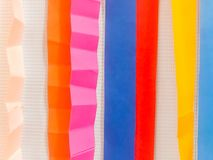 Colored paper strips decorate on board royalty free stock image
