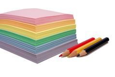 Colored paper and three pencils Stock Photo