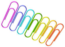 Colored paperclips diagonal row Royalty Free Stock Photos