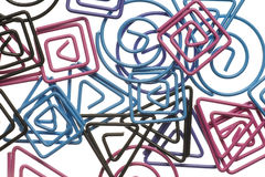 Colored paperclips isolated on white. Stock Image