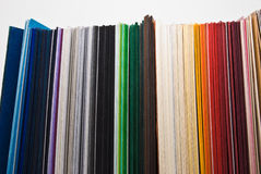 Colored papers. Colored paper stock stand on white background Stock Photography