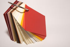 Colored papers. Colored paper stock stand on white background Stock Photo