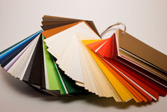 Colored papers. Colored paper stock stand on white background Royalty Free Stock Images