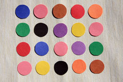 Colored papers. It is colored paper dots Stock Photos