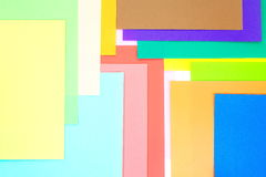Colored papers background Stock Images