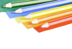 Colored papers and crayons Royalty Free Stock Photo