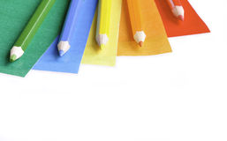 Colored papers and Pencils Stock Photos