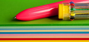 Colored papers and pens Royalty Free Stock Photos