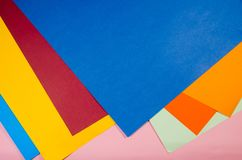 Colored papers in a pile royalty free stock image