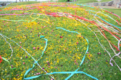 Colored papers placed and Flower on Grave in Qingming Festival. Qingming Festival is when Chinese people visit the columbarium, graves or burial grounds to pray Royalty Free Stock Image