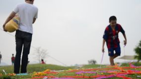 Colored papers placed and Flower on Grave in Qingming Festival stock video footage