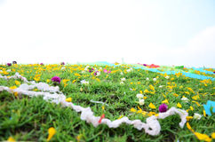 Colored papers placed on a grave during Qingming Festival. Qingming Festival is when Chinese people visit the columbarium, graves or burial grounds to pray to Royalty Free Stock Photography