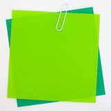 Colored papers with staple. Background photo of Colored papers with staple Stock Photo