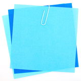 Colored papers with staple Royalty Free Stock Images