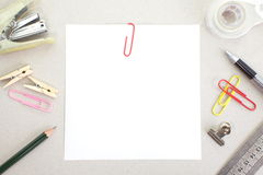 Colored papers with staple and stationery Stock Photo