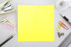 Colored papers with staple and stationery. Photo of Colored papers with staple and stationery Stock Images