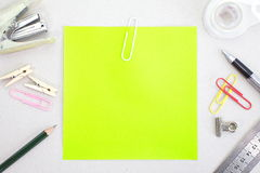 Colored papers with staple and stationery. Photo of Colored papers with staple and stationery Royalty Free Stock Image