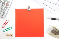 Colored papers with staple and stationery. Photo of Colored papers with staple and stationery Royalty Free Stock Images