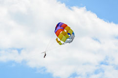Colored parasail wing in the blue clouds sky, Parasailing. Also known as parascending or parakiting royalty free stock photo