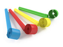 Colored party favor horns . Whistle Stock Images