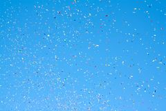 Colored party popper. Colored confetti flying in the blue sky Stock Photography