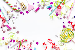 Colored party sweets and confetti on white background top view mockup. Colored party spiral sweets and confetti on white table background top view mockup stock photos