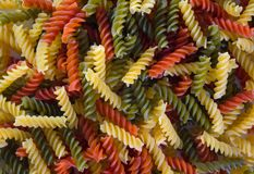 Colored pasta in the form of a spiral. Close-up. Multicolored italian pasta stock photo