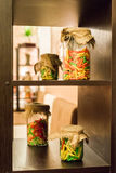 Colored pasta in glass jars. Dry colored pasta in glass jars on the shelf Stock Photo