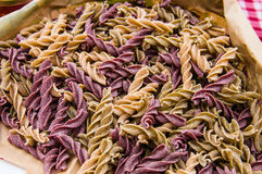Colored pasta in a market Stock Photo