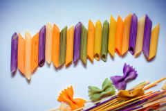 Colored pasta painted in different color brush Stock Photo