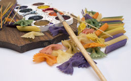 Colored pasta painted in different color brush. Cool Stock Images