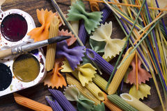 Colored pasta painted in different color brush Royalty Free Stock Photo