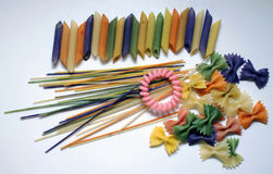 Colored pasta painted in different color brush. Draw Royalty Free Stock Images