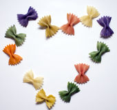 Colored pasta painted in different color in the shape of a heart Royalty Free Stock Photo