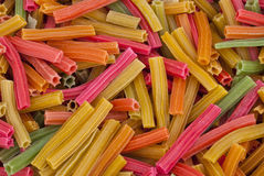 Colored pasta pieces as seen on street market Stock Photos
