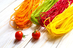 Colored pasta with vegetables royalty free stock photo