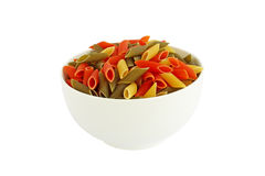 Colored pasta in white bowl Stock Photography