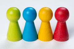 Colored pawns Stock Photos