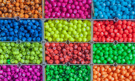 Colored pearls at a flee-market. Some colorful plastic pearls - found on a flee-market Royalty Free Stock Photography