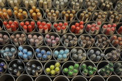 Colored pearls in tubes Stock Photography