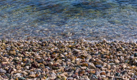 Colored pebbles on the sea beach. Stones background. Royalty Free Stock Photography