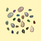 Colored pebbles. On yellow background, vector illustration Royalty Free Stock Image