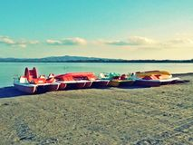 Colored pedal boats on the beach. Pedal boats of various colors on teh beach in Italy Royalty Free Stock Image