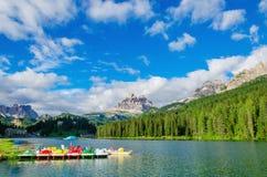 Colored pedalos on Lake Misurina, Dolomites, Italy Royalty Free Stock Photography